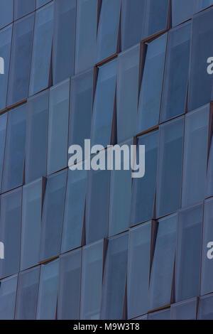 a beautiful detail shot of a modern building, blue windows, Milan, Italy - Stock Photo