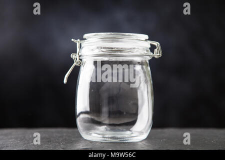 Glass jar on dark background - Stock Photo