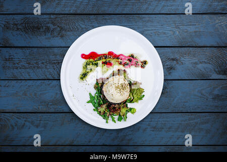 Slice of eggplant with mozzarella cheese and tomatoes. - Stock Photo
