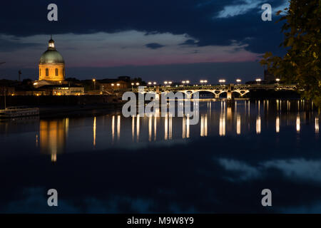 Dome de la Grave and Sainte Pierre bridge at night time - Stock Photo