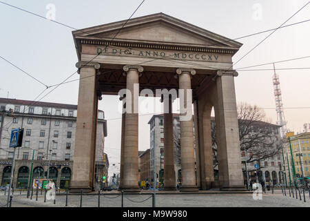 Milan, Italy Porta Ticinese neoclassical city gate. Granite structure with pillars at Navigli area, honoring Napoleon's victory in Marengo. - Stock Photo