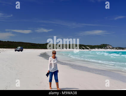 Tourist walk along the stunning white sand of Lucky Bay in the Cape Le Grand National Park, west of Esperance, south coast, Western Australia - Stock Photo