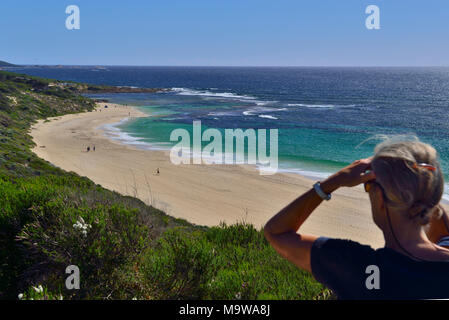 Woman looking south  along  Yallingup beach towards Yallingup.   Yallingup, Western Australia - Stock Photo