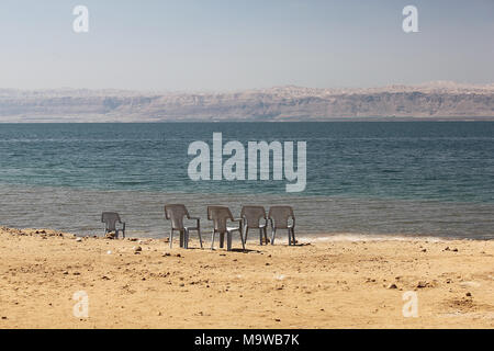 The Dead Sea shore seen from Jordan, with Israel in the distance. At 790 metres below sea level, the valley is one of the lowest land masses on Earth. - Stock Photo
