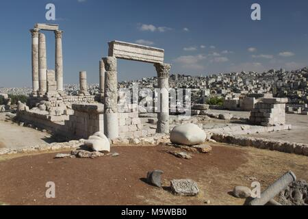 The Roman Temple of Hercules in the Amman Citadel, In the foreground are a marble hand and elbow, all that remains of a colossal stature of Hercules. - Stock Photo