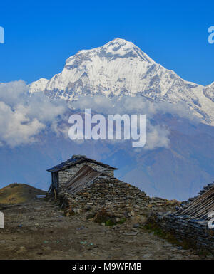 Mountain houses with snow peak of Annapurna Range in Khopra, Nepal. - Stock Photo
