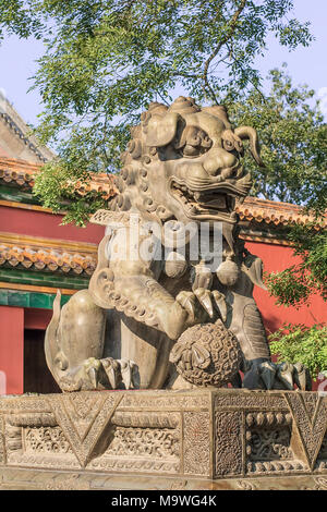 BEIJING-SEPT. 19, 2009. Guardian Lion in front of an ornamented pavilion at Yonghe Lamasery, also known as Lama Temple, monastery of the Gelug school  - Stock Photo