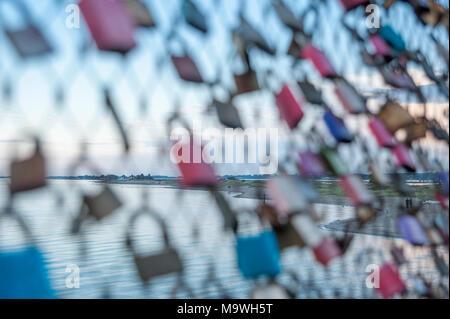 Love locks on the pier, Heiligenhafen, Baltic Sea, Schleswig-Holstein, Germany, Europe - Stock Photo