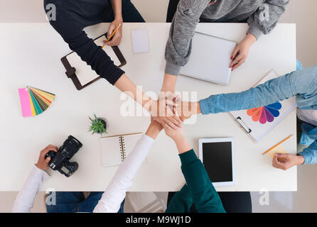 Young creative team having a meeting in creative office - teamwork concepts. - Stock Photo