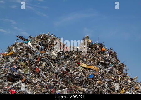 Mountains of collected scrap metal at a recycling junkyard in Amsterdam the Netherlands. - Stock Photo