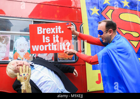 London, UK. 29th March 2018. A Pro Europe protester fights with a Boris Johnson impersonator as Anti Brexit protesters dressed in  comic superhero costumes prepare to bring their message of defiance on the first anniversary of Article 50 for Britain to leave the European Union Credit: amer ghazzal/Alamy Live News - Stock Photo