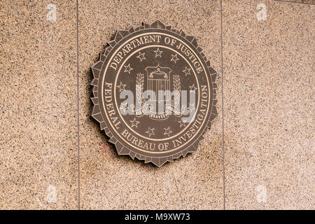 WASHINGTON, DC - MARCH 14, 2018: Seal of the Federal Bureau of Investigation on the J. Edgar Hoover FBI Building in Washington, DC - Stock Photo