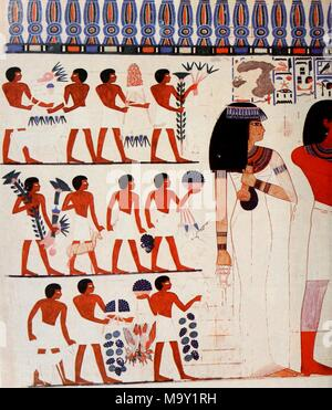 Color illustration depicting a painted wall from the interior of the Theban tomb of the Pharoah Nakht, showing half of Nakht, and his wife Tawy, at right, in full-length view, both on their way to offer sacrifices to the Gods, with three rows of offering bearers, carrying fruit, cranes, a deer, etc, following from left, and the original grid lines for the rough draft still partially visible, from the article 'Paintings from the Tomb of Nakht at Thebes' by William J Murnane, published in the Field Museum of Natural History, Bulletin 51, 10 'Ancient Egypt', 1981. Courtesy Internet Archive. () - Stock Photo
