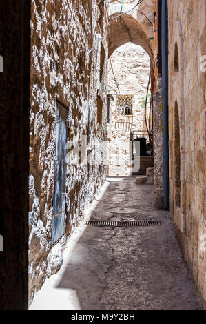 Narrow stone street in ancient Old Town of Jerusalem, Israel - Stock Photo