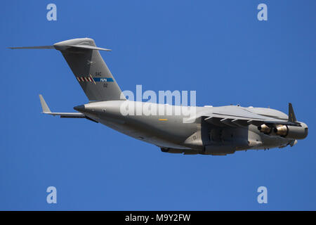 GILZE RIJEN, THE NETHERLANDS - Hungarian Air Force Boeing C-17 Globemaster III cargo plane overflight. The plane belongs to SAC and is used by a conso - Stock Photo