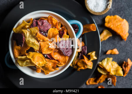 Mixed fried vegetable chips in pot. - Stock Photo