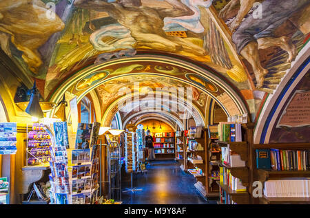 Littera bookshop, in Vinius University, in the heart of Vilnius old town, Lithuania with painted ceilings by Antanas Kmieliauskas - Stock Photo
