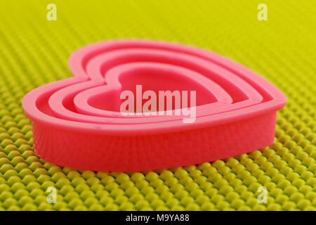 Pink plastic heart on  non skid mat - Stock Photo