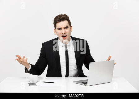 Business Concept: Portrait of screaming angry businessman sitting in office isolated over white background. - Stock Photo