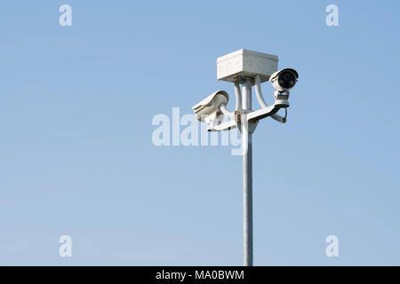 Outdoor CCTV camera security system, on blue background - Stock Photo
