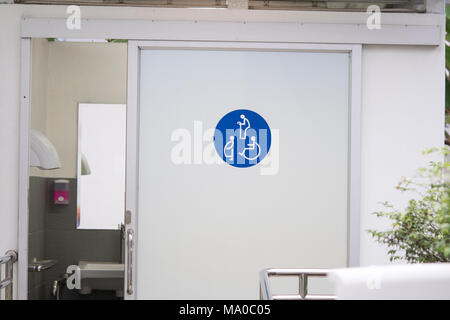 Entrance door to the Public toilet for disabled people, pregnant women, old people, Toilet sign on door - Stock Photo