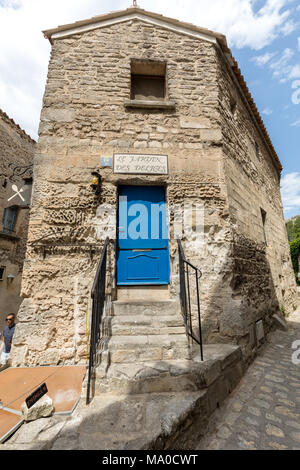 Les Baux de Provence, France - June 26, 2017: Street in medieval village of les Baux. Les Baux is now given over entirely to the tourist trade, relyin - Stock Photo