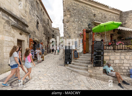 Les Baux de Provence, France - June 26, 2017: Street in medieval village of  Les Baux de Provence. Les Baux is now given over entirely to the tourist  - Stock Photo