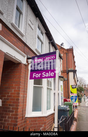 Purple Bricks estate agents for sale sign on a typical Britsh terraced street. - Stock Photo