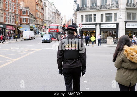 Rear view female policewoman City of London Police in uniform on the street in Central London England UK Great Britain   KATHY DEWITT - Stock Photo