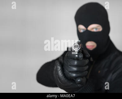 Portrait of armed man in balaclava indoors. Space for text. - Stock Photo