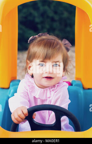 Little girl having fun in a park - Stock Photo