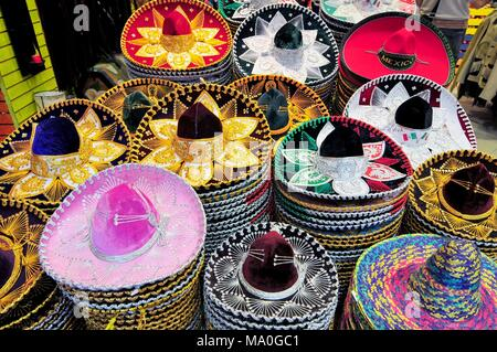 A stack of Sombreros in different sizes for sale in a Mexico City shop. - Stock Photo