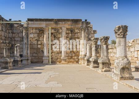 Ruins of the old synagogue in Capernaum by the Sea of Galilee, Israel. - Stock Photo