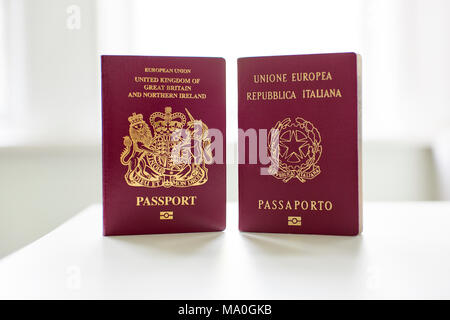 British and Italian passports standing next to each other. - Stock Photo