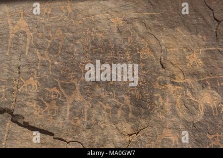 Prehistoric rock painting in the red sand desert Wadi Rum, Jordan. - Stock Photo