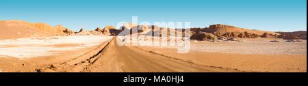 "Road and salt formations at ""Valle de la Luna"" (spanish for Moon Valley), San Pedro de Atacama, Los Flamencos National Reserve, Atacama desert, Antofa - Stock Photo"