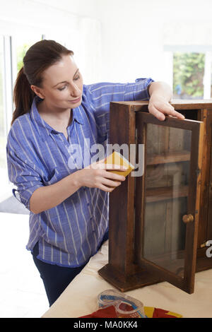 Woman Upcycling Wooden Cabinet At Home - Stock Photo