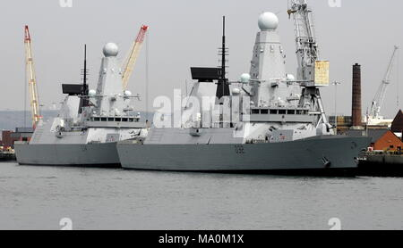 AJAXNETPHOTO. 25TH AUGUST, 2016. PORTSMOUTH, ENGLAND. - DIAMOND DEPLOYED - TYPE 45 DESTRPOYER HMS DIAMOND (D34) WAS DEPLOYED TO THE MEDITERRANEAN EARLY SEPTEMBER TO TACKLE PEOPLE SMUGGLERS OFF THE LIBYAN COAST. SEEN HERE MOORED ASTERN OF SISTER SHIP HMS DARING (D32) AT THE NAVAL BASE.  PHOTO:JONATHAN EASTLAND/AJAXREF:D162508_6043 - Stock Photo