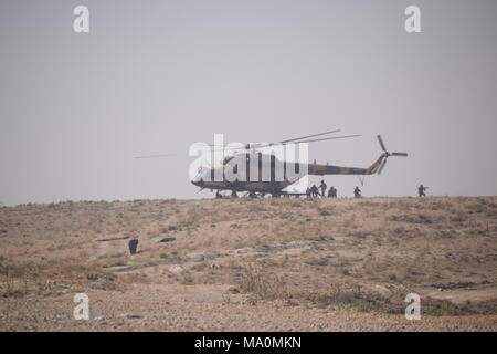 Afghan soldiers disembark from a Mi-17 transport helicopter of the Afghan Air Force during an exercise in the Kabul Military Training Centre (KMTC). - Stock Photo