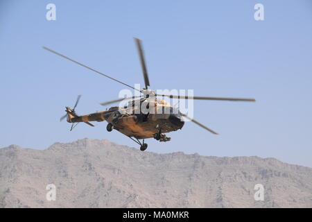 A Mi-17 transport helicopter of the Afghan Air Force flying in the sky over the Kabul Military Training Centre (KMTC), during an exercise. - Stock Photo