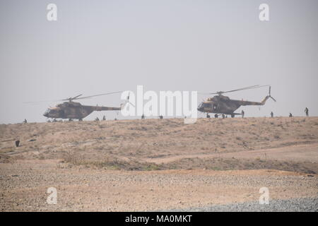 Afghan soldiers disembark from two Mi-17 transport helicopters of the Afghan Air Force and secure the area during a training exercise in the Kabul Military Training Centre (KMTC). - Stock Photo