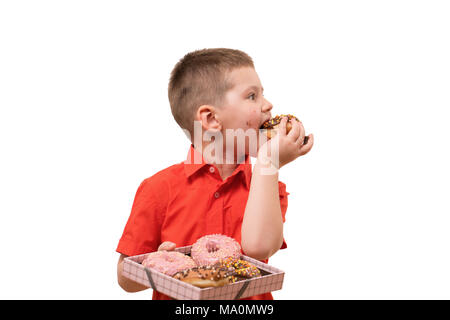 Adorable baby boy eat donut with chocolate. Isolate - Stock Photo