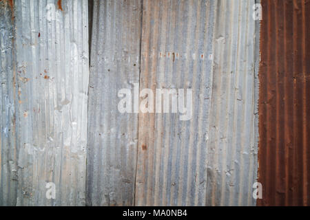 Rusty and corrugated iron metal construction site wall texture background with vignette. - Stock Photo