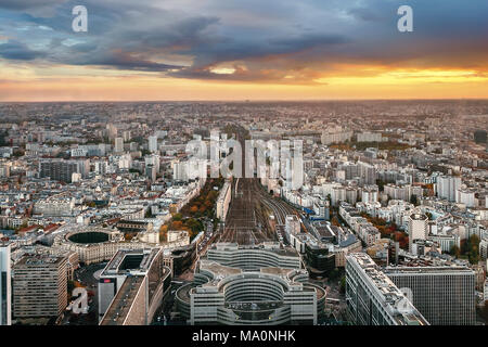Overview of Paris from Montparnasse Tower with Montparnasse train station in the foreground. France in autumn sunset. - Stock Photo