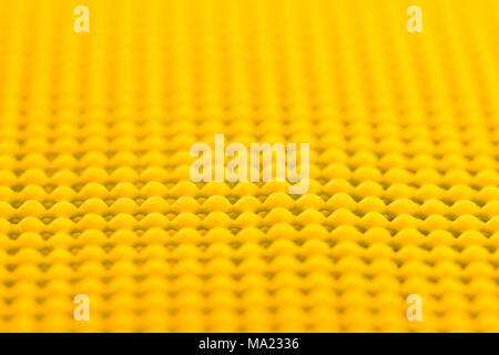 Close up detail of yellow textured non skid mat - Stock Photo