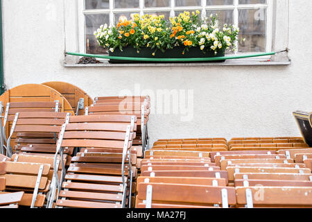Street city cafe. Tables and Chairs neatly stacked, waiting for people to use them at an event. Vienna, Austria. - Stock Photo