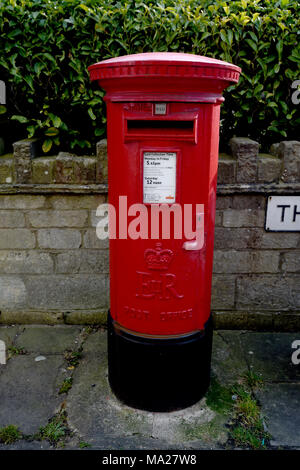 Red Royal Mail post box in the town of Devizes in the county of Wiltshire UK - Stock Photo