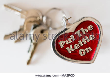 Put the kettle on written on a key ring fob, UK - Stock Photo