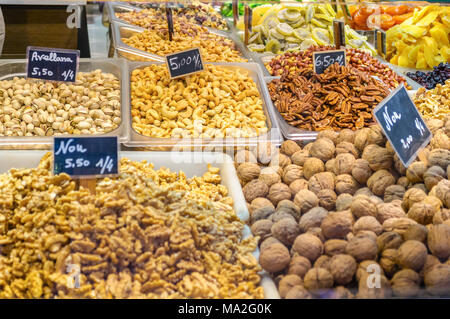 Valencia, Spain - February 24, 2018: Various type of nuts in the Central Market of Valencia, Spain - Stock Photo