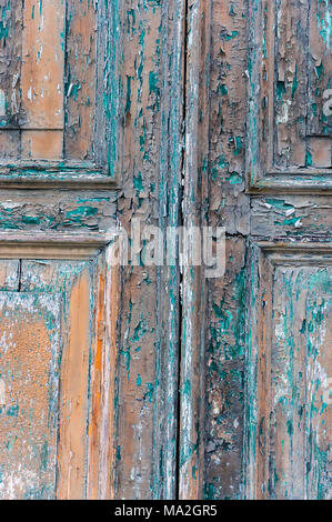 Abundance of old paint layers from different epochs on doors and windows in Venice Italy. - Stock Photo